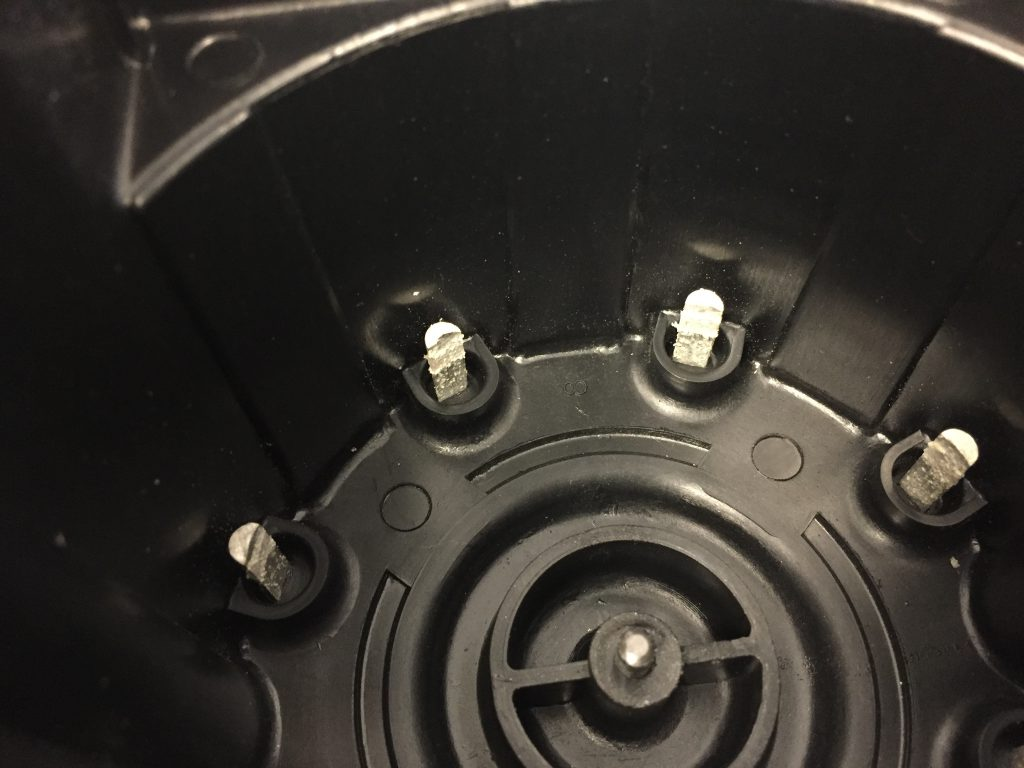 Generator distributor cap showing severe corrosion and electrical pitting.